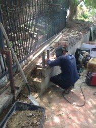 a man installing a gate
