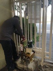 a man working with gate equipment during gate installation